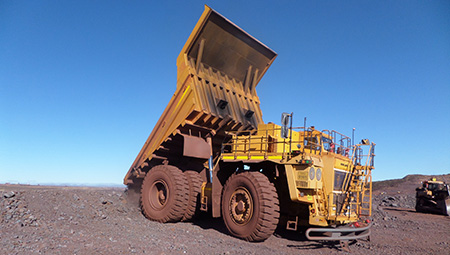 one of BELAZ-7513B (136 MT payload capacity) haul truck unloading material in a Lyleveld mine